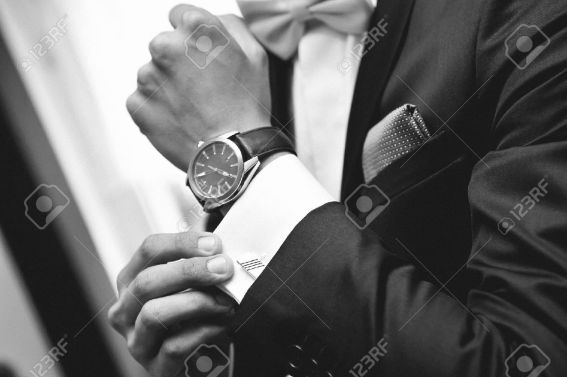 26729597-man-with-suit-and-watch-on-hand-stock-photo-luxury