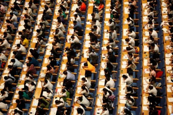 Students attend a lecture for the entrance exam for postgraduate studies at a hall in Jinan
