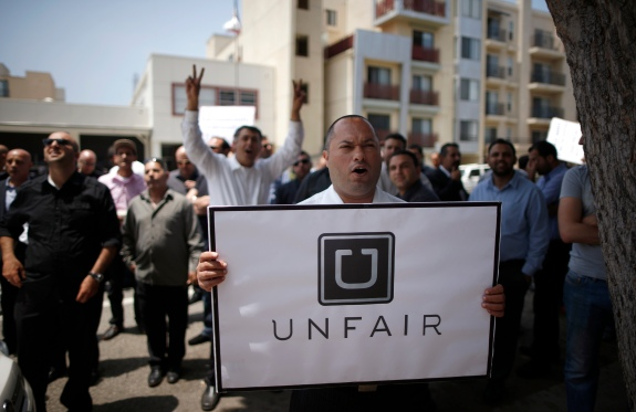 Uber drivers protest against working conditions outside the company's office in Santa Monica